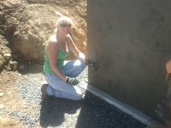 Kathy, Fritz's girlfriend, loves doing this kind of work. She and Janet parged the walk-out wall.